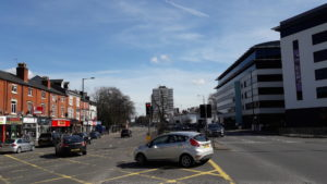 Hagley Road: pub and shops on the left and offices on the right (© Sue Conlan)